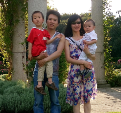Pastor Min Xing with his wife and sons